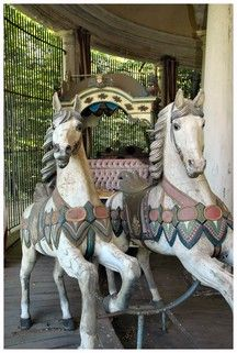 Wilhelmsbad Carousel horses and carriage, located in Hanau-Wilhelmsbad State Park, Germany. The oldest carousel in the world! This carousel was built around 1780, and was originally man-powered.