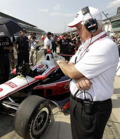 IndyCar car owner Roger Penske, right, checks his watch as time runs down on the first day of qualifications for the Indianapolis 500 auto race as his driver Ryan Briscoe, of Australia, sits in his at the Indianapolis Motor Speedway in Indianapolis, Saturday, May 19, 2012. Briscoe won the pole for the race. (AP Photo/Darron Cummings) #Indycar