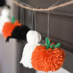 This too-cute-to-be-true garland proves Halloween decor doesn't have to be frightening or eccentric to fit the theme. Make the Halloween craft: Use fishing line to hang yarn spiders, ghosts, and pumpkins to a long string of twine. Tie the fishing line to the twine in loose knots so you can space the critters evenly once you hang the garland on your mantel./