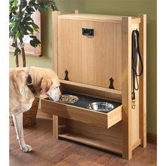 This Wood Pet Feeding Station brings food up to snout level for healthier, safer eating.