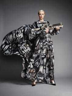 """The actress who plays the fearsome """"Chrometrooper"""" in Star Wars: The Force Awakens models the gown inspired by the character."""