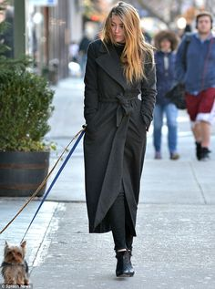 Amber Heard walking her two pooches in NYC wearing a long black trench coat.