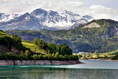 This HD wallpaper is about landscape photography of mountains surrounded by body of water, Original wallpaper dimensions is file size is Water Poster, Mountain Wallpaper, 1080p Wallpaper, Swiss Alps, Original Wallpaper, Rocky Mountains, Cover Photos, Landscape Photography, Nature