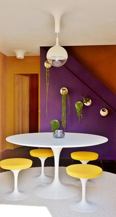 the hanging pots, the pendant, tulip chairs table...!