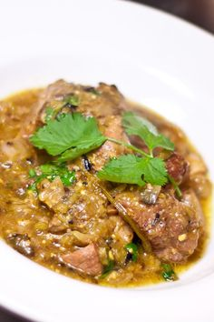 Excellent take on New Mexican Chile Verde. It's similar to the NM grannie recipe I have, but there are subtle differences. One- marinate the meat for an hour beforehand and roast the onions and garlic instead of fry them. It made for a deep and rich stew.   | Greeen Chili Recipe | Chili Recipes