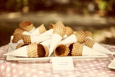 Wrap sugar cones with scrapbook paper to match theme.