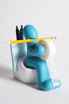 holds pens, post-its, pencils, and also a tape dispenser. effing brilliant.
