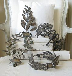 "Metal Laurel Leaf crowns and ""sprays"" were used in France, Holland and Belgium to award people for their achievements or services, as our trophies do today."