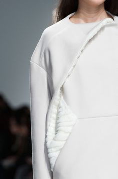 Structured dress with textured fur & twisted construction; white fashion details // Hussein Chalayan FW14