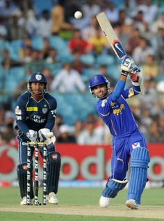 Rajasthan Royals batsman Ajinkya Rahane (R) plays a shot as Deccan Chargers wicketkepwser Kumar Sangakkara looks on during the IPL Twenty20 cricket match between Rajasthan Royals and Deccan Chargers at The Sawai Mansingh Stadium in Jaipur on April 17, 2012.