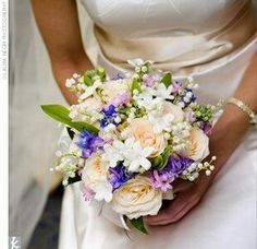 Lovely Bridal Bouquet Comprised Of: Pastel Peach Roses, Blue Delphinium, Pink & Purple Hyacinth, White Stephanotis & Lily Of The Valley