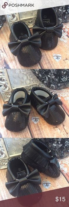 Boutique Baby Girl Sparkle Black Sequin Shoes Great accessory for any outfit in baby's closet. Black glitzy Sequin Moccasin Shoes with black fringe trim and bows on top. Very cute with or without socks. Size 1 (0-6 mos) Size 2 (6-12 mos) Size 3 (12-18 mos) Shoes Baby & Walker
