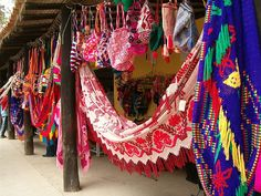 in venezuela there is a difference between hammocks (hamacas) and chinchorros, wayúu hammocks. chinchorros are handmade, knit usually without needles, and its yarn is more flexible than a normal hammock's. Malta House, Boho Decor, South America, Beautiful Places, Tapestry, Crafty, Outdoor Decor, Outdoor Living, Inspiration