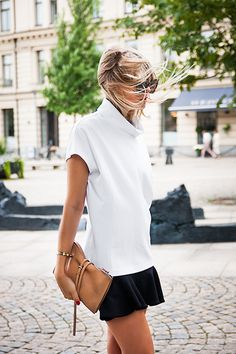 Short black skirt and white top...classy and simple.