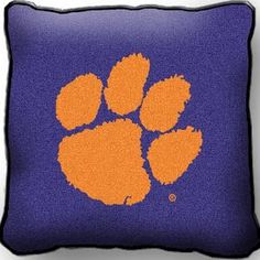Featuring the iconic Tigers Paw logo, this Clemson Tigers Paw Throw Pillow is the perfect addition to your home or dorm room. Clemson Tiger Paw, Tiger Logo, College Football Playoff, Decorative Throw Pillows, Tapestry, University, Alma Mater, Theatre, Spirit