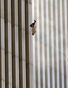 """A decisive moment: The Falling Man. Photographer: Richard Drew. Man falling from World Trade Center, 9:15:15am September 11, 2001."""