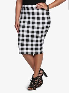 Form fitting. Check. Black and white plaid pattern. Check. Trend-on midi length. Check. This flattering contemporary skirt meets our hot list of approval and should definitely be on your check list of must-haves.