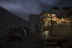 US military personnel wait in line for Thanksgiving dinner at a coalition airbase in Qayara, Iraq.