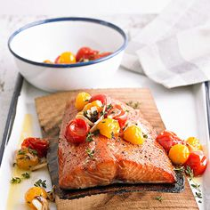 Planked Salmon with Grilled Tomato Salsa. Grilling is a go-to method for cooking easy salmon recipes. We infused this fish fillet with smoky flavor by grilling it on a cedar plank. Dollop on grilled tomato salsa for a juicy finishing touch. Best Salmon Recipe, Delicious Salmon Recipes, Grilled Salmon Recipes, Healthy Salmon Recipes, Fish Recipes, Seafood Recipes, Yummy Food, Grilled Fish, Dinner Ideas