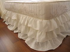 Ivory linen Dust ruffle. A beautiful, country chic bed skirt, great to add a country chic touch to any decor. Three tiers of ruffles in linen, a soft fabric with great drape. It makes any bedding set special.