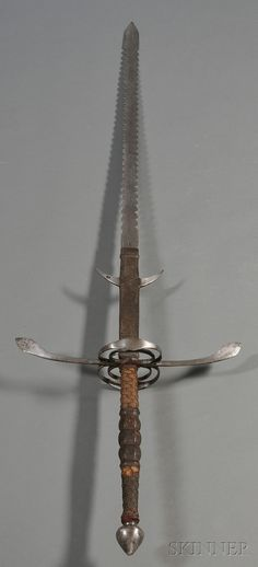 Two handed flamberge sword. It's interesting that the blade is serrated, I've never seen that on a sword blade, nonetheless a two hander