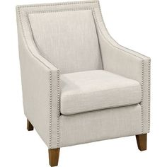 A classic addition to your living room or parlor, this stylish arm chair showcases nailhead trim and neutral beige upholstery.  Prod...