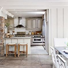 Nature-Inspired Lake House Kitchen Hand-poured concrete countertops pick up the floor's gray tones in this kitchen