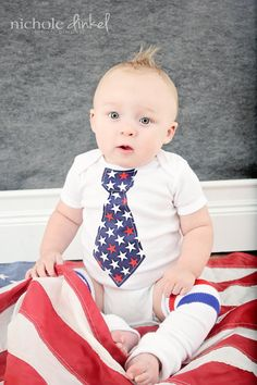 A professional photographer who is ignorant of, or does care about US flag etiquette. The US flag is not any ordinary piece of cloth. Nothing should be placed upon a US flag -- even your cute baby. DO NOT repin without this disclaimer. Thank you.