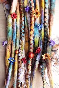 colorful dreads! wool tie-dye dreadlocks with flowers and bohemian beads.
