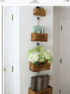 Wood boxes hung to left of canning room door.