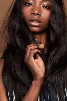 "Nude Lips Like You've Never Seen Them Before #refinery29  http://www.refinery29.com/nude-lipsticks#slide-2  Deep With Warm UndertonesGeorgie's skin has warmer, reddish tones, so Cochrane made sure to stay away from anything beige or neutral. ""If you put a color like that on, it will pop too much from her skin tone, and not look natural,"" she says. (Hello, concealer lips.) Instead, Cochrane reached for a Make Up For Ever shade in an icy, ruddy brown. ""It has a little bit of a shine t..."