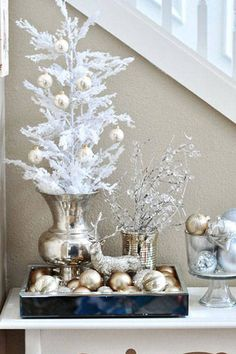White and gold accents put a glam spin on holiday decor.    - HarpersBAZAAR.com