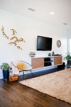 floating credenza, wood and white. Cass & Carla's Elegant, Playful Home