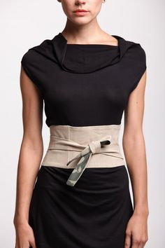 How to make an Obi belt. An obi belt/ waist corset would be a very good thing for clothing such as a t-shirt tunic dress with slitted sides- it defines the waist and makes the the outfit look better; it creates shape that would otherwise not be there & it draws in your stomach.
