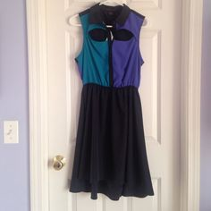 Dress Fun, comfortable dress. Features cut outs at front bodice and in the back! Slightly longer hemline in back of dress. 100% poly Material Girl Dresses High Low