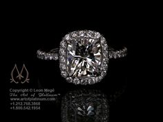 Halo Cushion Engagement Ring by Leon Mege