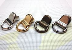 Gancio con anello snodato e rivetto art. GN491 - Ganci - Minuteria - Metallo - Minuteria e Accessori - Materiali per la produzione - Collini Atomi di Scarpa, Vendita on-line di forniture per calzaturifici, pelletterie, accessori calzature