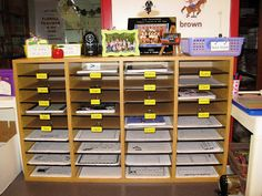 mailboxes with large clips, student names are laminated and then taped to bottom of clip then clipped into mailbox :)