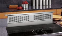 vents for cooking stoves | Telescopic downdraft system rises over the cooktop in both island and ...