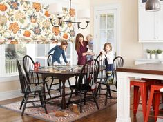 """Bonus: Roman shades require about half the fabric that drapes do, so they're a money-saving option, especially for a large expanse. """"The four shades that span across the windows are like art for the room,"""" says Madelyn. Wilmington Multi Roman shade fabric, $27 per yard, calicocorners.com"""