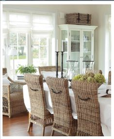 Basket on top of cabinet and the detail of the little strap handle on the chairs.such a charming room