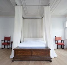 I love the idea of using curtain rails on the ceiling for bed curtains