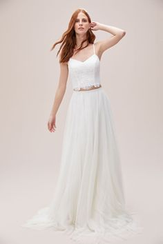 A whimsical approach to a traditional wedding dress, this two-piece set features a spaghetti-strap lace top with a buttoned back and a sweeping, A-line tulle skirt. Available in Sydney, Melbourne & Online. Affordable Bridal, Traditional Wedding Dresses, Boho Bride, Bridal Gowns, Tulle, Alice Springs, Melbourne Wedding, Byron Bay, Formal Dresses