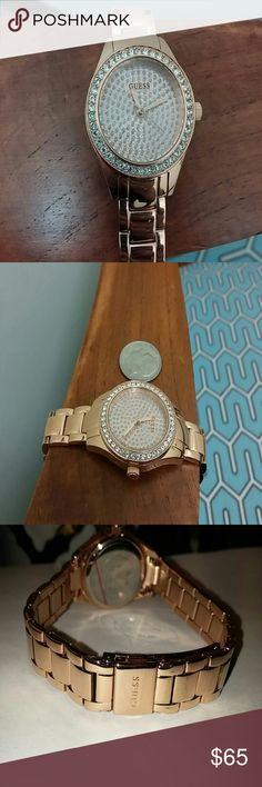 Guess Auth Gold and Crystal Face Womens Watch As seen in image. Rare rose gold metal band with white crystal surrounding face bezel and the interior face. Stunning watch face is about the size of a quarter. Substantial weight, stainless steel with safety latch band.   Worn once, does not match my wedding set so selling, but really nice piece. Like new! Battery is fully functioning.   No box or other items just the watch. Watch has the clear plastic tab on the back of the face. No trades…
