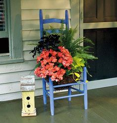 Turn a vintage chair into an inviting moveable planter.  At left, an old chair brimming with blooms is right at home on this welcoming porch. Choose plants that complement each other and your chair, and don't be afraid to mix colors or add a houseplant.