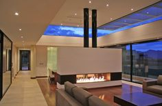 Spectacular Ultramodern Residence Exposing Luxurious Design: Comfortable Contemporary Living Room With Fireplace And Surprising Windows On Top Of Wall Presenting The Beautiful Sky View ~ FreeSharing Villa Inspiration