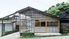 Japanese firm ROOVICE transformed a converted warehouse into this café and bagel shop in the small coastal Japanese town of Miura, deploying transparent corrugated polycarbonate siding to give the existing timber frame a modern flavor.