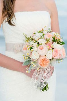 Beautiful bouquet with peach Juliet roses. Very suitable for a beach wedding.