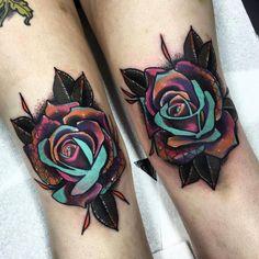 Matching pop art rose tattoos on both knees.                                                                                                                                                                                 More