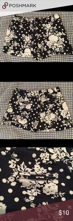 "New York & Company Navy/White Patterned Shorts Size four New York & Company shorts. They are dark navy and white, with flowers and polka dots. Cotton/spandex. They have a clip closure and ""seamed pockets"" like the type you would see on khakis, but you can actually put stuff in them haha. These shorts are super cute and would look great with a plain white t-shirt and wedges, or maybe a white tank top! I wore these shorts a few times but have washed them. I can't fit in them anymore so I'm…"